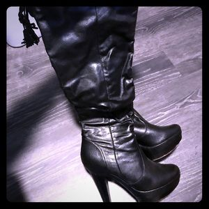Black leather fold over the knee high heel boots